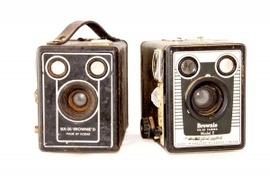 Two Vintage Cameras On White Background